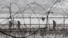 South Korean army soldiers patrol along barbed-wire fences at the Imjingak Pavilion, near the demilitarized zone of Panmunjom, in Paju, South Korea, Tuesday, Feb. 12, 2013 (Ahn Young-joo/Associated Press)