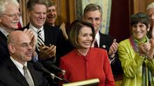House Democrats clap for Speaker of the House Nancy Pelosi (D-CA) during a press conference after a vote on health care on Capitol Hill November 7, 2009 in Washington, DC. The House of Representatives passed the healthcare reform bill 220 to 215 after a late-night vote. (Brendan Smialowski/2009 Getty Images)