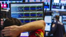 A trader rubs his head as he looks up at informational screens while working on the floor of the New York Stock Exchange shortly before the closing of the market in New York, August 15, 2013. U.S. stocks had the biggest one-day percentage drop since late June on Thursday in higher-than-average trading volume after poor results and outlooks from Dow components Wal-Mart and Cisco. (LUCAS JACKSON/REUTERS)