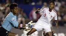 Canada's Candace-Marie Chapman (9) looks at Canada's goalie Karina Leblanc during the final against Mexico in the CONCACAF Women's World Cup qualifying soccer tournament at the Andres Quintana Roo stadium in Cancun November 8, 2010. (STRINGER/MEXICO/REUTERS)