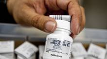 Pharmacist Bandal Shakeel with oxycodone prescriptions at University of Washington's medical center in Seattle, Jan. 25, 2012. (STUART ISETT/NYT)