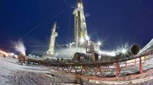 Nexen shale gas rigs in the Horn River Basin at Dilly Creek, B.C. CNOOC Ltd.'s bid for Calgary-based Nexen has reopened the debate over foreign ownership and state-owned enterprises. (David Olecko/Nexen)