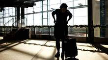A passenger waits in the departure area of the Edmonton International Airport on Nov. 29, 2010. (JASON FRANSON FOR THE GLOBE AND MAIL)