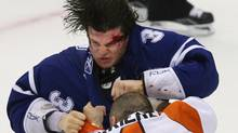 Toronto Maple Leafs' Garnet Exelby, top, bleeds from his forehead while fighting Philadelphia Flyers' Ian Laperriere in Toronto on Saturday, September 19, 2009. (Darren Calabrese)
