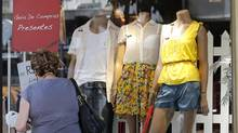 A woman walks past a shop in Rio de Janeiro November 30, 2012. (SERGIO MORAES/REUTERS)