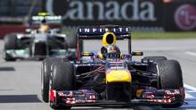 Red Bull driver Sebastian Vettel of Germany celebrates after winning the Canadian Grand Prix in Montreal, Sunday, June 9, 2013. (Graham Hughes/THE CANADIAN PRESS)
