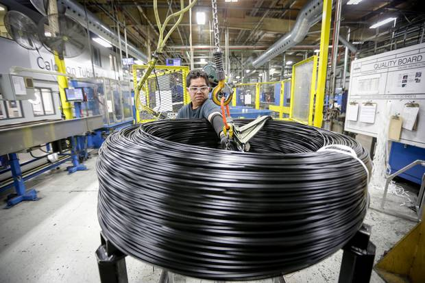 A worker prepares coiled brake lines for shipping to Mexico at the end of the production line at Caledon Tubing – a division of Martinrea International – in St. Marys, Ont., in 2016.