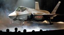 The F-35 Joint Strike Fighter is shown during an Lockheed Martin news conference in Fort Worth, Tex., on July 7, 2006. (Ron T. Ennis/AP)