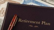 A retirement plan portfolio on top of stock certificates. (Kenneth Mellott/iStockphoto)