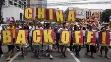 Protesters march towards the Chinese consulate in Manila during on May 11, 2012. (Pat Roque/AP/Pat Roque/AP)