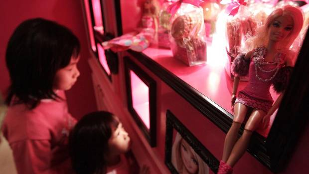 Girls look at Barbie dolls on display during the media preview of the café in Taipei Jan. 30, 2013. The café is located in the bustling Zhongxiao Dunhua shopping area. (PICHI CHUANG /REUTERS)