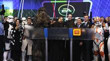 "Electronic Arts Inc. executives stand with Star Wars characters to ring the opening bell at the NASDAQ Market Site in New York, December 20, 2011. EA was celebrating Tuesday's launch of EA's ""Star Wars: The Old Republic"" game and the re-listing of Electronic Arts Inc. on the NASDAQ under the new symbol ""EA"". Pictured are (2nd R-L) NASDAQ Executive Vice President of the Corporate Client Group Bruce Aust, President of EA Labels Frank Gibeau, EA Senior Vice President Ray Muzyka and EA Vice President Greg Zeschuk. (MIKE SEGAR/Mike Segar/Reuters)"