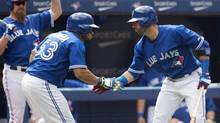 Toronto Blue Jays Melky Cabrera, left, and Jose Bautista celebrate Cabrera's solo home run in the sixth inning of MLB baseball action against the New York Yankees at the Rogers Centre in Toronto on Sunday, August 31, 2014. (Darren Calabrese/THE CANADIAN PRESS)