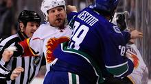 Calgary Flames forward Brian McGrattan (16) and Vancouver Canucks forward Tom Sestito (29) fight in the first 2 seconds of the first period at Rogers Arena. (Anne-Marie Sorvin/USA Today Sports)