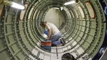 Cessna employee Dwight Bennett works inside of a jet during a tour of the Cessna business jet assembly line at their manufacturing plant in Wichita, Kansas August 14, 2012. (JEFF TUTTLE/REUTERS)