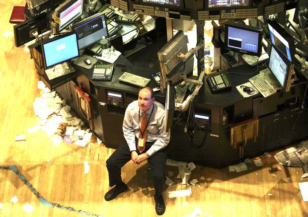 A trader on the floor of the New York Stock Exchange after the day's trading close on Wednesday, April 25, 2007.
