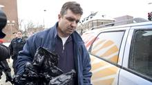 Former chief executive of the Norbourg investment company and convicted fraudster Vincent Lacroix arrives at a half-way house in Montreal Thursday, January 27, 2011 after being released from prison. (Graham Hughes/The Canadian Press/Graham Hughes/The Canadian Press)