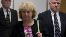 Randi Connor, the Crown counsel who entered a stay of proceedings in January, 1998, for charges related to an alleged attack involving Robert Pickton one year earlier makes her way into testify at the missing woman's inquiry in Vancouver on April 10, 2012. (John Lehmann/Globe and Mail/John Lehmann/Globe and Mail)