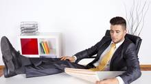 Businessman relaxing at his office (Helder Almeida/Getty Images/iStockphoto)