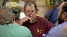 "Kevin Parham, 47, centre, talks with friends while eating dinner at Rowan Helping Ministries, a homeless shelter in Salisbury, N.C., on Mon., Oct. 31, 2011. "" (JOHN W. ADKISSON/John W. Adkisson for The Globe and Mail)"
