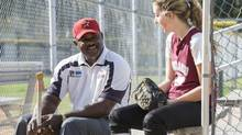 Reviving Baseball in Inner Cities president Michael Holmes, left, talks with Casey Moore, 17, about her plans for college at Settegast Park, November 10, 2012, in Houston, Texas. Houston RBI has been serving Houston area youth since 1997 with a variety of summer and fall baseball and softball programs, assistance with SAT preparation and mentoring of high school and college bound students. (Dave Einsel For The Globe and Mail)