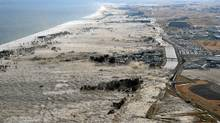 A massive tsunami hits the coastal areas of Iwanuma, Miyagi Prefecture, northeastern Japan, March 11, 2011. (Kyodo/Reuters/Kyodo/Reuters)
