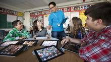 Royan Lee, a teacher at Beverley Acres Public School uses technology to create a more interactive, collaborative and social classroom. He is seen teaching Zinedine Jina-Pettersen, 12, Alessandra Tuzi, 12, Michelle Bennett, 12, and Kamran Rahbar, 12, how to use GarageBand for the iPad. (JENNIFER ROBERTS/Jennifer Roberts/The Globe and Mail)