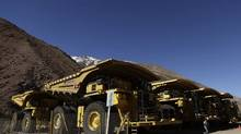 Trucks sit parked at Barrick Gold's Pascua-Lama project in this file photo. (Jorge Saenz/AP Photo)