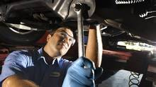 Auto mechanic fixing vehicle (Thinkstock Images/Getty Images)