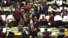 The trading floor at the Nigerian Stock Exchange: African stocks are seldom traded in the West, making them difficult for small investors to find. (AKINTUNDE AKINLEYE/REUTERS)