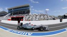 Mercedes Formula One driver Michael Schumacher of Germany drives in the pit lane during the first practice session of the Japanese F1 Grand Prix at the Suzuka circuit October 5, 2012. (KIM KYUNG-HOON/REUTERS)