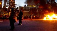 Riot officers keep a perimeter around two burning police cars in downtown Vancouver June 15, 2011 during the Stanley Cup riot. John Lehmann/The Globe and Mail (John Lehmann/The Globe and Mail/John Lehmann/The Globe and Mail)