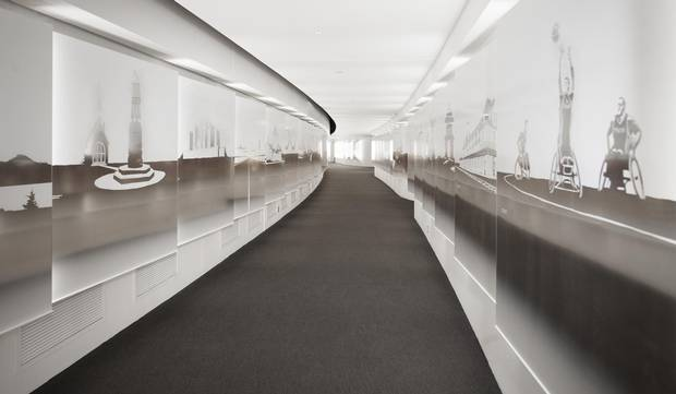 The passageway through the hall is lined with 101 silhouettes of familiar Canadian landmarks, symbols and activities
