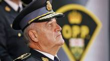Outgoing Ontario Provincial Police commissioner Julian Fantino listens during a change-of-command ceremony in Toronto on Aug. 31, 2010. (Darren Calabrese/THE CANADIAN PRESS)