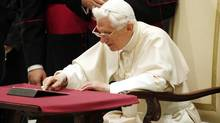 Pope Benedict XVI posts his first tweet using an iPad tablet after his Wednesday general audience in Paul VI's Hall at the Vatican, Dec. 12, 2012. (GIAMPIERO SPOSITO/REUTERS)
