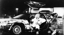 "Inventor Doc Brown (Christopher Lloyd) explains the workings of his DeLorean time machine to a fascinated Marty McFly (Michael J. Fox) in ""Back to the Future."". (File photo, 1985) (Universal City Studios)"