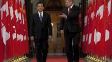 Prime Minister Stephen Harper, right, and Chinese President Hu Jintao walk through the Hall of Honour on Parliament Hill in Ottawa. (Adrian Wyld/Adrian Wyld/The Canadian Press)