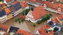 The city hall of Grimma, eastern Germany, is surrounded by floods Monday, June 3, 2013. Flooding has spread across a large area of central Europe following heavy rainfall in recent days (Jens Wolf/AP)