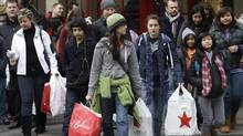 Shoppers in Seattle on last year's Black Friday. For dedicated deal hunters on both sides of the border, Black Friday in the U.S. is hands down the biggest shopping day of the year. (Ted S. Warren/AP/Ted S. Warren/AP)