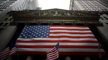 An American flag hangs outside the New York Stock Exchange in this file photo. One way to view the newly emerged Ambac Financial Group is as a low-priced option on the future prosperity of the U.S. economy and the recovery of the housing market. (ERIC THAYER/REUTERS)