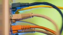 Ethernet cables plugged into wall socket (Comstock Images/Getty Images/Comstock Images)