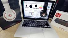 Beats Audio equipment is arranged for a photo next to an Apple laptop at Best Buy in Boston on May 9, 2014. (Michael Dwyer/THE CANADIAN PRESS)