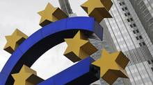 A structure showing the Euro currency sign is seen in front of the European Central Bank headquarters in Frankfurt on July 11, 2012. (ALEX DOMANSKI/REUTERS)