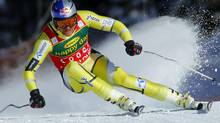 Norwegian skier Aksel Lund Svindal in action to win the Men's World Cup Super-G race in Lake Louise, Alberta, November 25, 2012. (MIKE BLAKE/REUTERS)