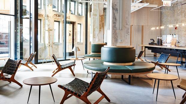 The Hollander, a hotel-hostel hybrid boasts plenty of beautiful exposed brick and distressed paint in its lobby, an homage to the space's industrial roots.