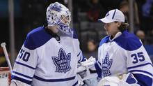 Toronto Maple Leafs goalie Jonas Gustavsson is congratulated by back up goalie Vesa Toskala after their team defeated the Boston Bruins during their NHL hockey game in Toronto, December 19, 2009. REUTERS/Mark Blinch (MARK BLINCH)