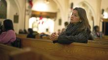 Fay Arellano prays at Our Lady of the Assumption Catholic Church in Toronto. (Kevin Van Paassen/The Globe and Mail)