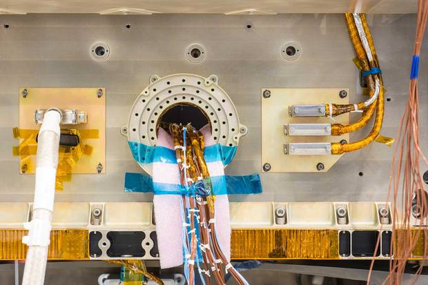 A detail of the Radarsat Constellation Mission satellite being built at the MDA clean lab