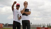 F1 driver Lewis Hamilton, left, is all of 5-foot-seven. He is shown here with race engineer Phil Prew at the Canadian F1 Grand Prix in Montreal in 2008. (Jim Young/Reuters)