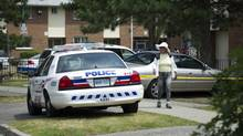 Police keep a presence on Danzig St. in Scarborough, Ont., July 18, 2012, after the community was rocked by a shooting that killed two people. (Kevin Van Paassen/The Globe and Mail)
